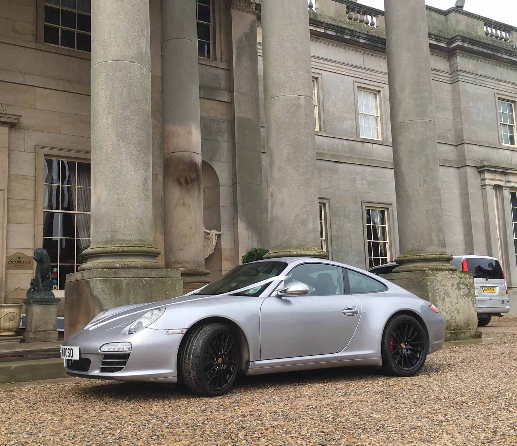 My car at our wedding venue. I had to get a picture outside such a beautiful building!
